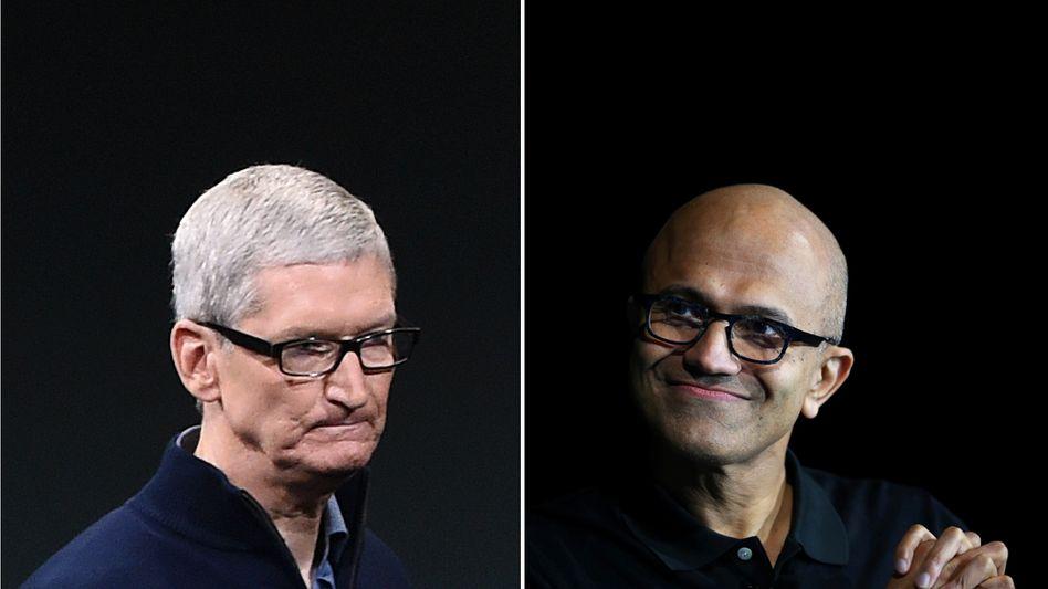 Wer ist der neue Steve Jobs? Microsoft-Chef Satya Nadella (r.) hat offenbar eher das Zeug dazu als Apples Tim Cook