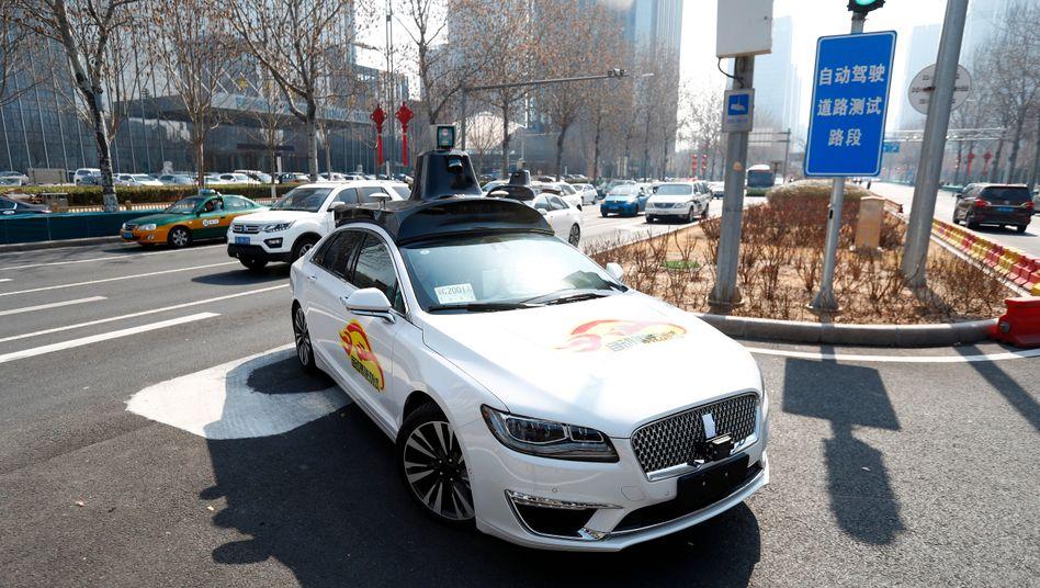 Selbstfahrendes Auto in Peking: Im autoritären China geht offenbar einiges einfacher als in den streitigen Demokratien des Westens.