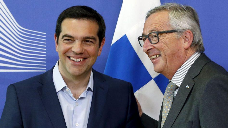 Zumindest lächeln sie: Fortschritte gab es nach den Verhandlungen zwischen Tsipras und Juncker nicht zu vermelden. Aber nett war es trotzdem