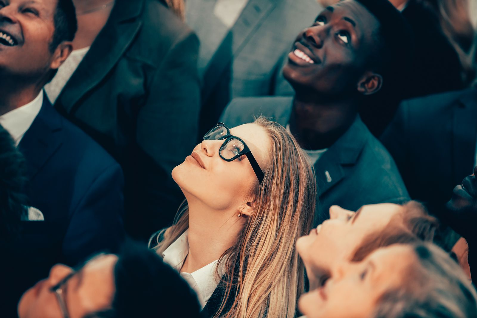 group of happy young business people looking up