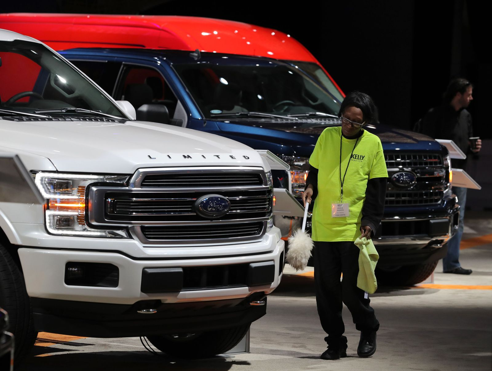 Worker cleans Ford pickup truck at the North American International Auto Show in Detroit, Michigan