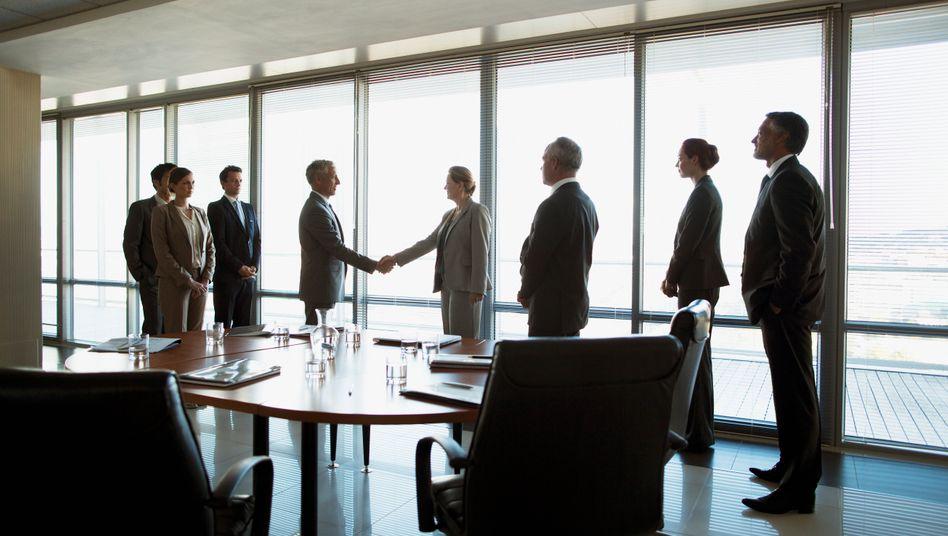 Sieht einfach aus, wird aber immer komplexer: Die Einigung bei Firmenkäufen (Symbolbild).