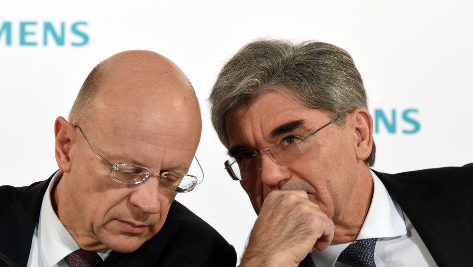 Leihen sich Geld und machen dabei Gewinn: Siemens-Finanzchef Ralf P Thomas (links) und Konzernchef Joe Kaeser.