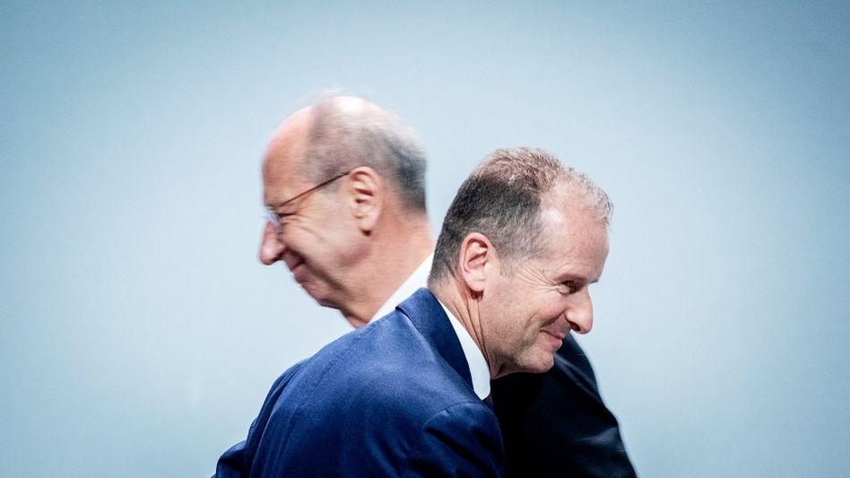 Auflagen akzeptiert: Herbert Diess und Hans Dieter Pötsch (beide links und rechts)