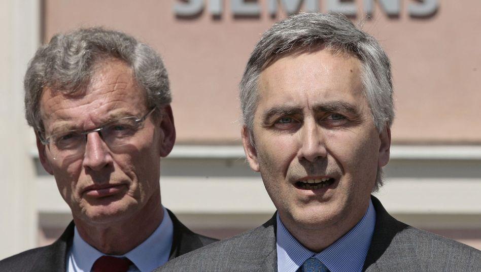 Siemens-Chefkontrolleur Gerhard Cromme (links, mit dem scheidenden Vorstandschef Peter Löscher): Ist das Kontrollgremium zu einem Neuanfang fähig?