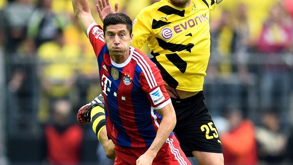 Ähnliche Rivalen: Eine Versicherung hält Anteile und gibt dem Stadion seinen Namen, der Ausstatter hat sich ebenfalls eingekauft - Bayern München und Borussia Dortmund verbindet mehr als nur die Feindschaft