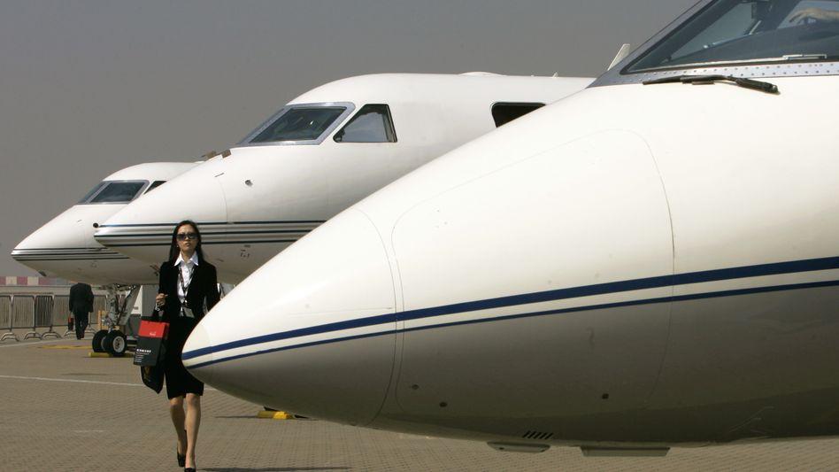 Flugzeuge des Typs Gulfstream, die gerne von Superreichen als Privatjets genutzt werden, auf einer Messe in Hongkong.