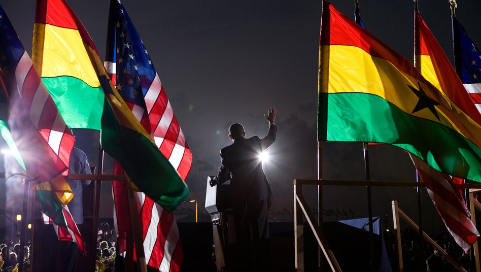 People in Accra, Ghana, cheer during a departure ceremony for President Obama after his visit in July 2009