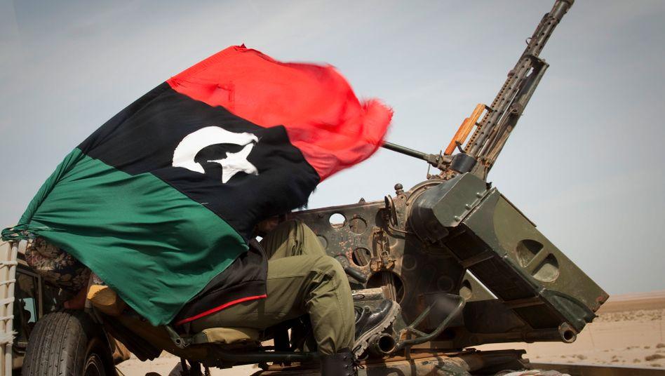 Libysche Regimegegner: Auch dank der Unterstützung des westlichen Militärbündnisses haben die Rebellen mittlerweile die wichtigsten Ölhäfen des afrikanischen unter ihre Kontrolle bringen können