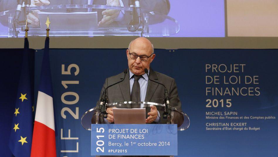 Französischer Minister Sapin: Herabstufung zur Kenntnis genommen