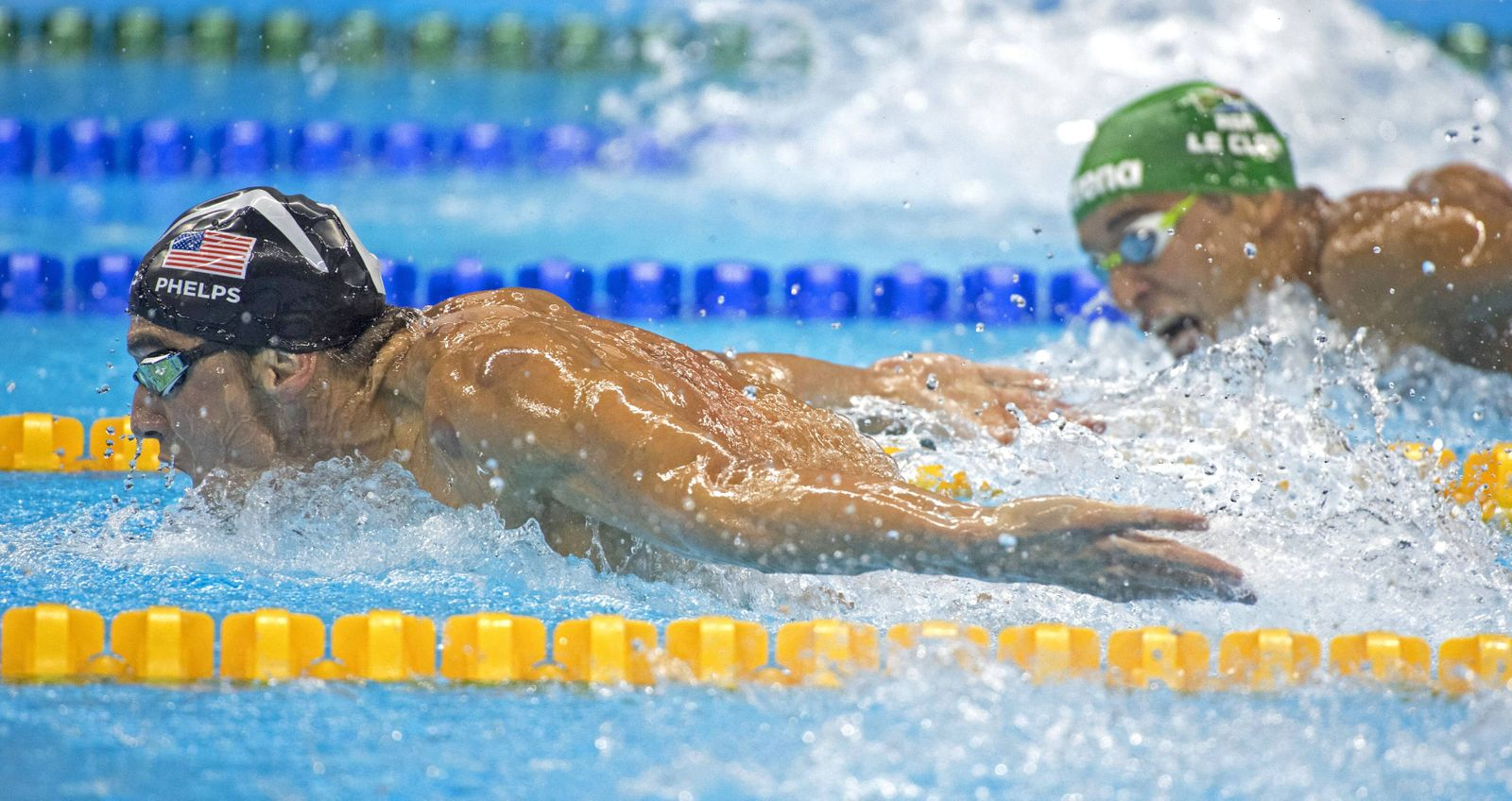 August 9, 2016 - Rio - Michael Phelps flies through the water as Chad Guy Bertrand le Clos of South