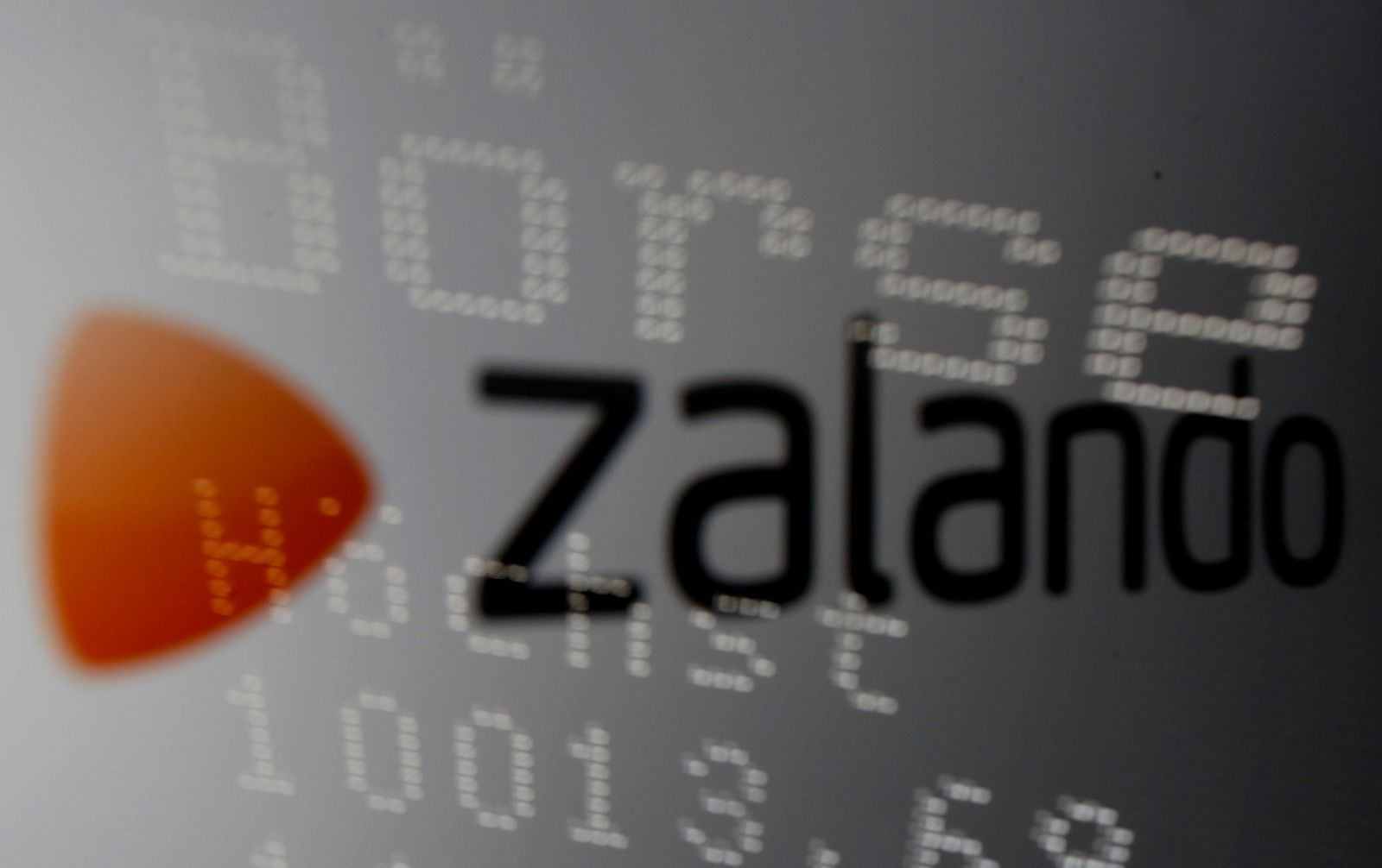 German stock market graph reflected on an iPad display showing Zalando logo picture illustration