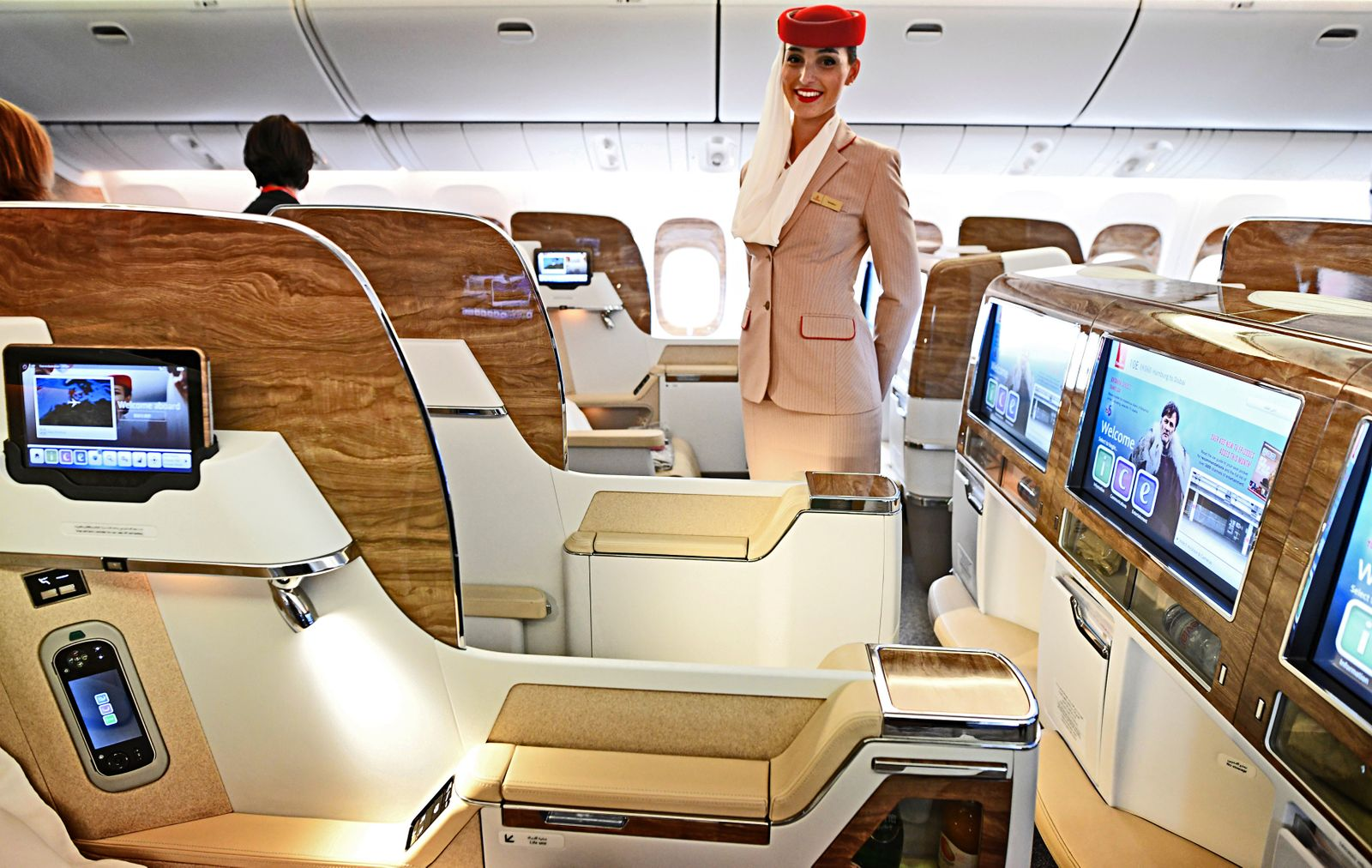 A stewardess of Emirates Airlines, stands in the first class during a presentation of Emirates' Boeing 777 at the airport in Hamburg