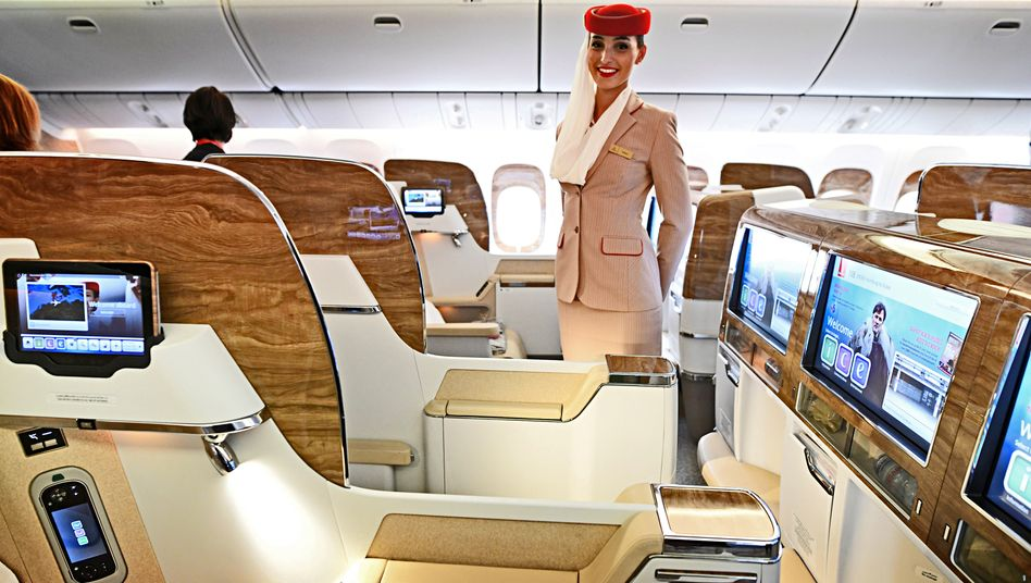 A stewardess in the first class of Emirates' Boeing 777