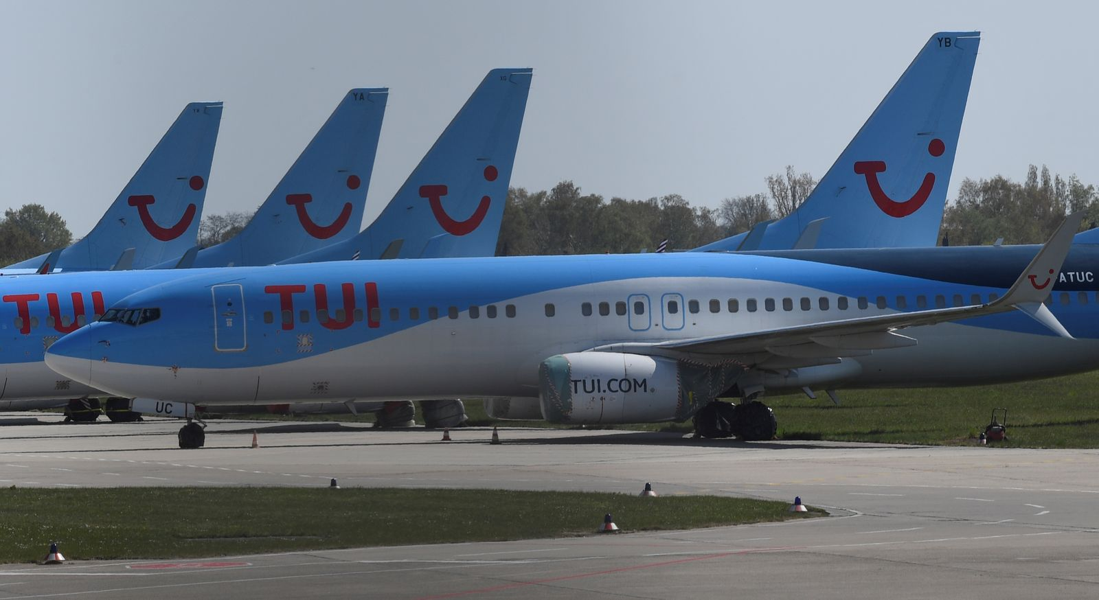 Planes of the German carrier Tui are parked on a closed runway during the spread of the coronavirus disease (COVID-19) at the airport in Hanover,