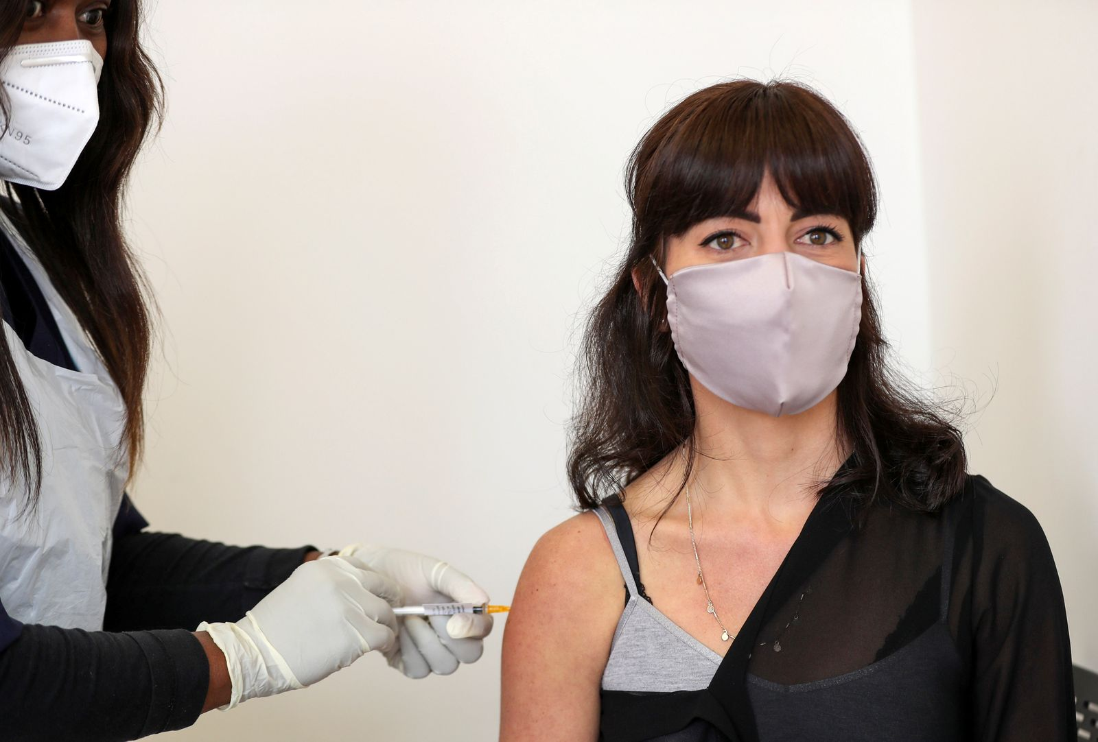 Robyn Porteous, a vaccine trials' volunteer, is injected as part of the country's human clinical trial for potential vaccines after being tested for the coronavirus disease (COVID-19), at the Wits RHI Shandukani Research Centre in Johannesburg