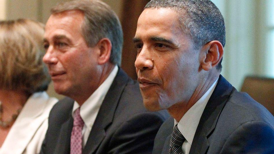 Erbitterter Streit: Der demokratische US-Präsident Obama kann sich nicht mit seinem republikanischen Kollegen John Boehner auf eine Erhöhung der Schuldengrenze einigen