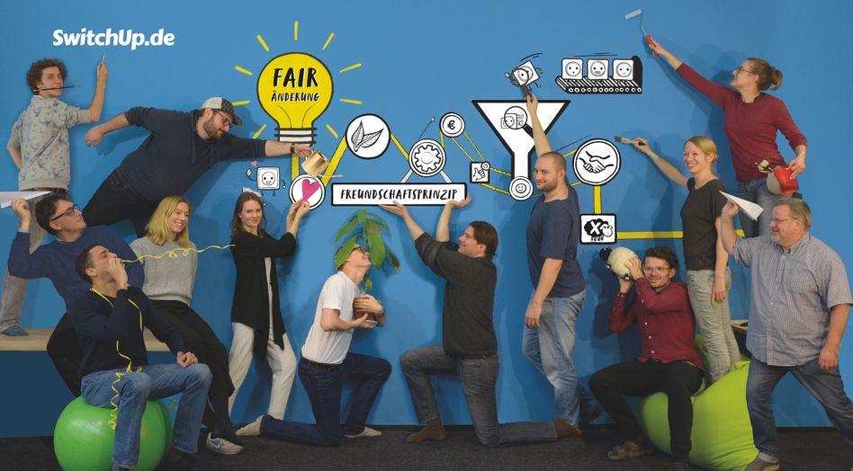 Switchup-Team mit Gründer Arik Meyer in der Bildmitte