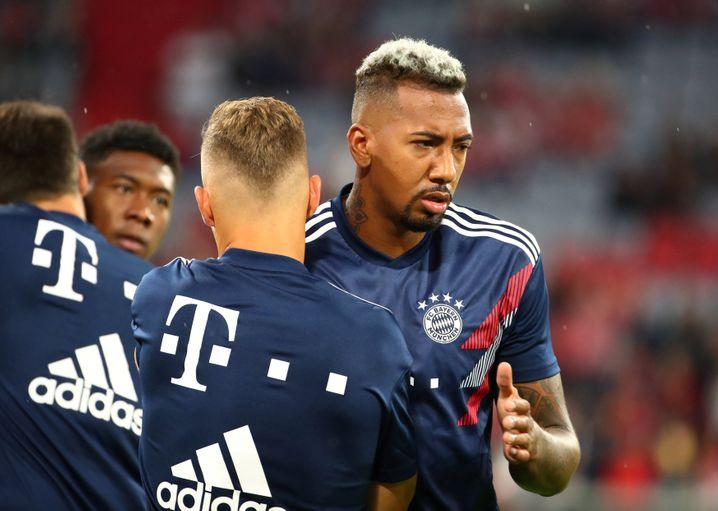 Erblondet: Fußballer Jerome Boateng (rechts) beweist Modemut bei der Frisurenwahl