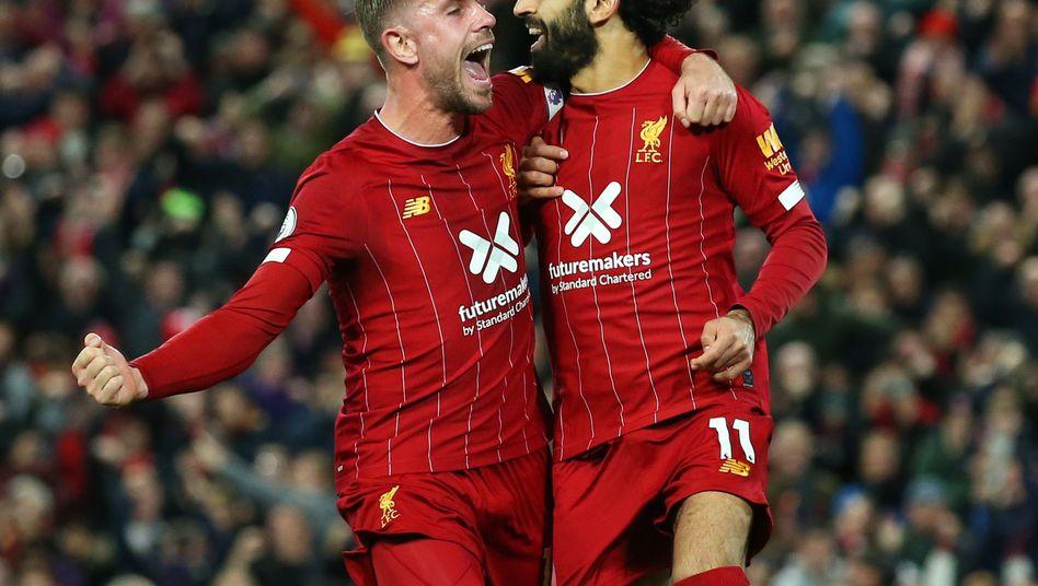Liverpools Kapitän Jordan Henderson (links) mit Top-Stürmer Mohamed Salah