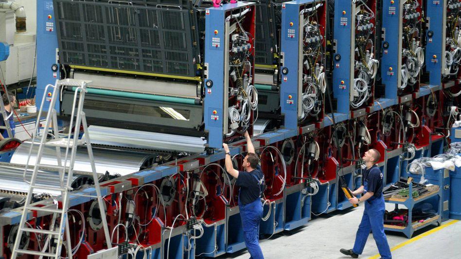 Druckmaschinen aus Dresden: Der deutsche Maschinenbau ist mit seinem laufenden Geschäft zufrieden und zeigt sich optimistisch für das Jahr 2012