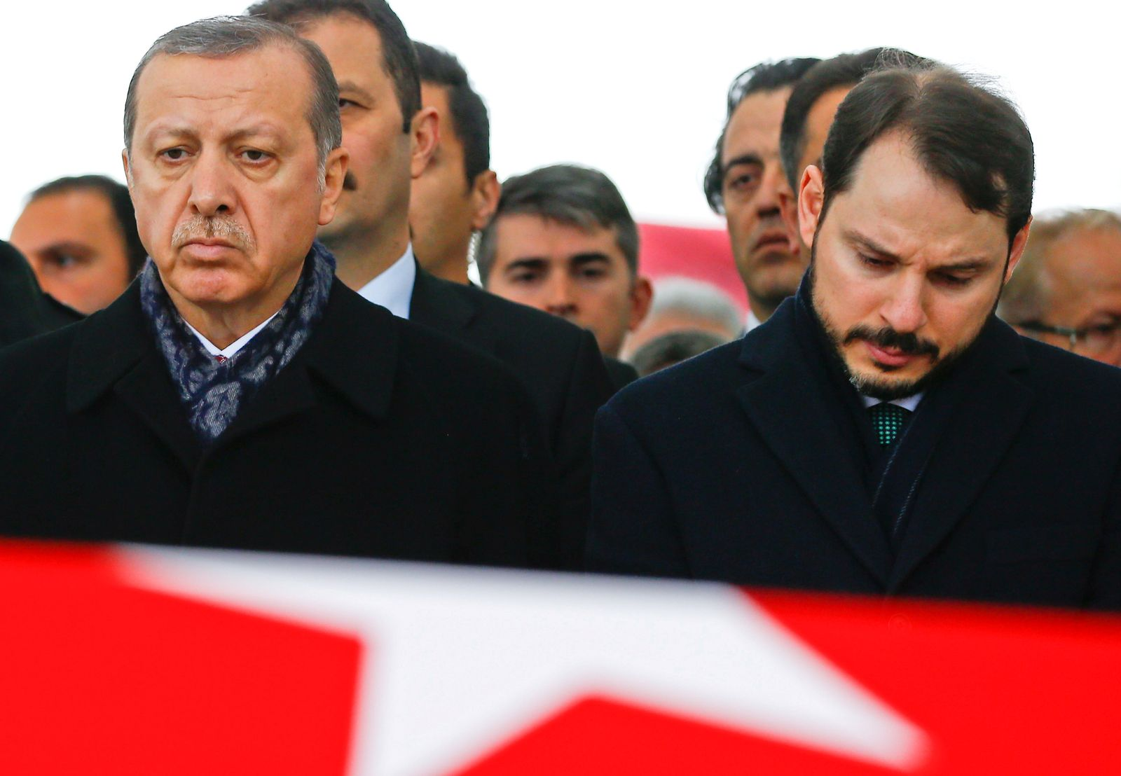 FILE PHOTO: Turkish President Erdogan attends a funeral ceremony for police officer Hasim Usta who was killed in Saturday's blasts in Istanbul