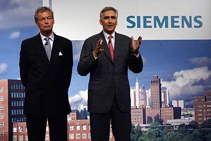 In vielen Punkten noch vage: Siemens-Primus Löscher (r.)