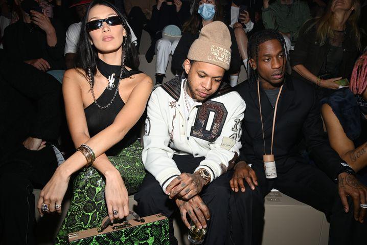 Menschen als Marketing-Booster: Im Juni kamen Model Bella Hadid, DJ Chase B und der US-Rap-Star Travis Scott zur Männermodenshow des Luxushauses Dior nach Paris