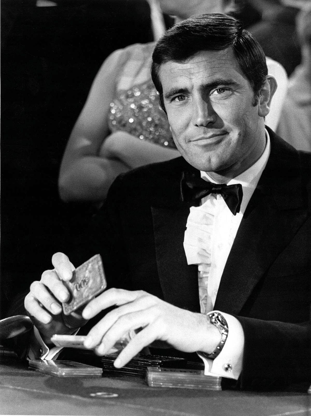 George Lazenby as Bond with his Rolex 6238