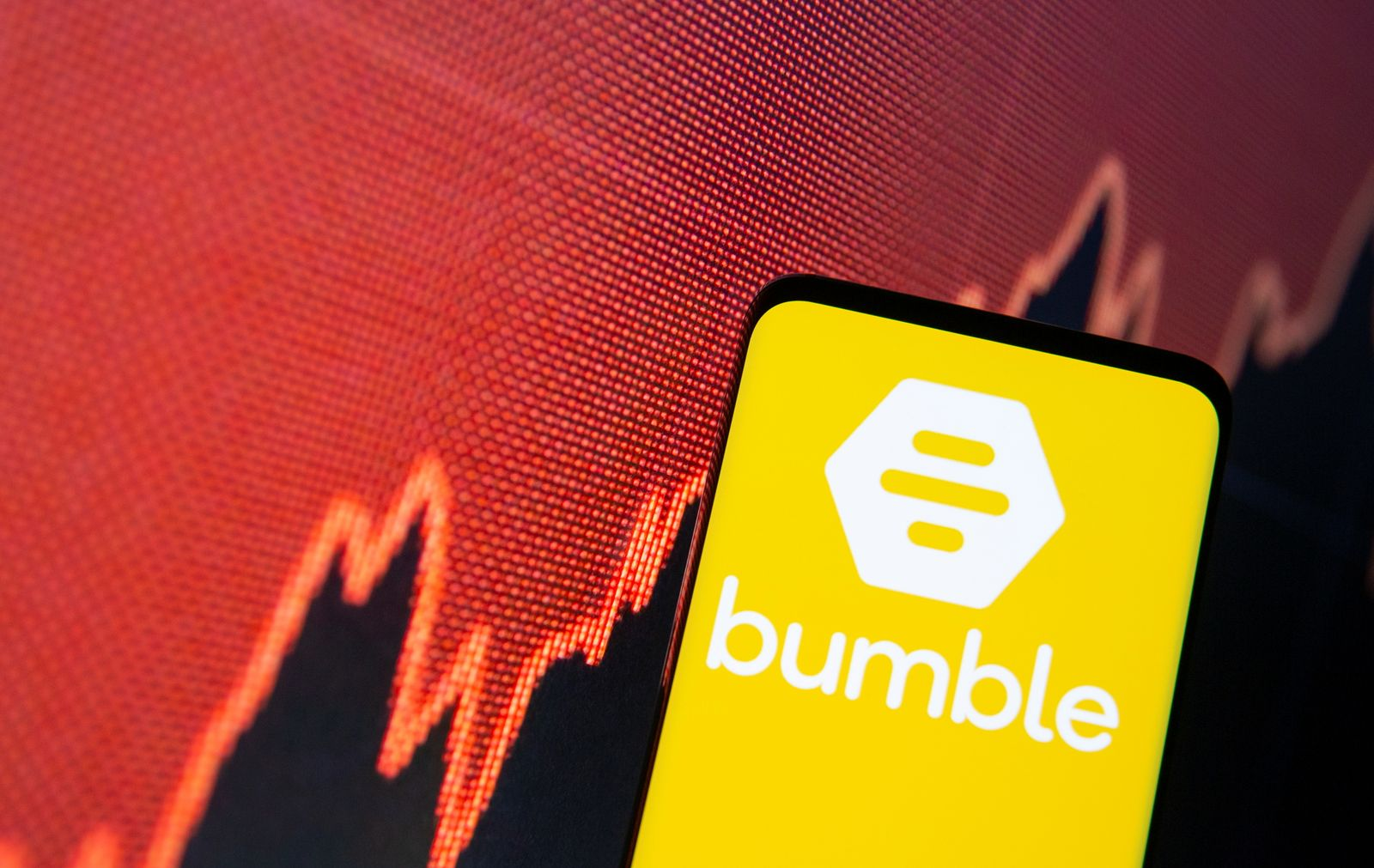 The Bubmble logo is seen on a smartphone in front of a stock graph in this illustration