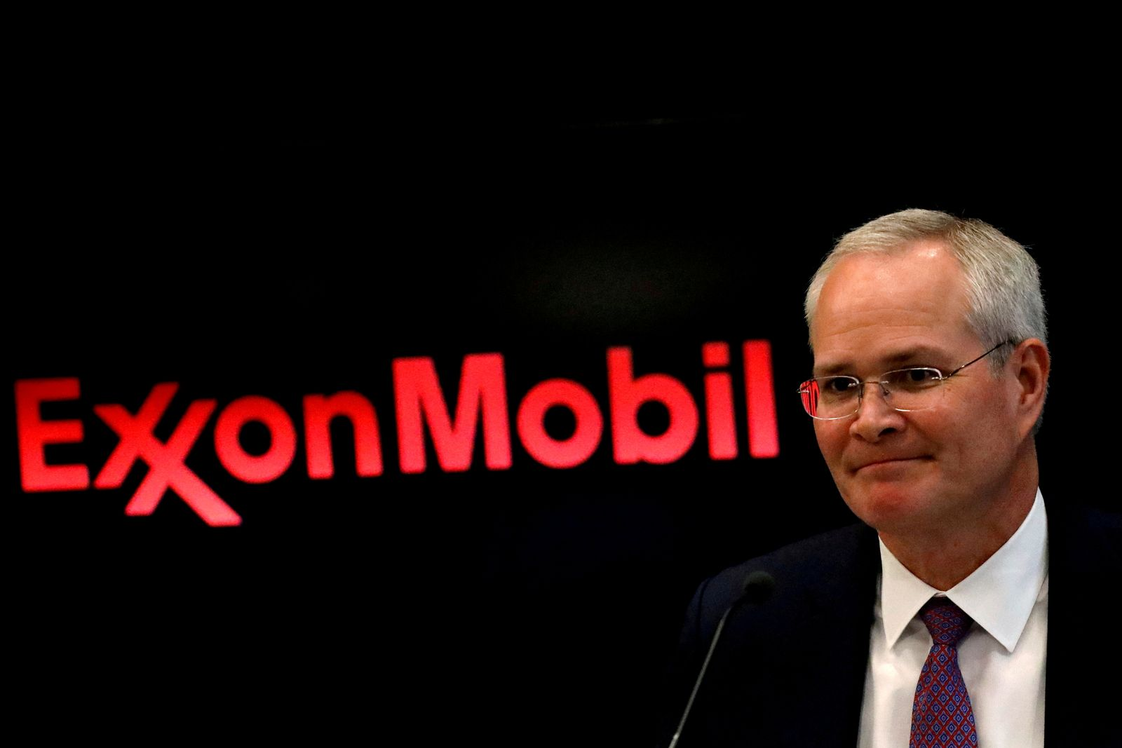 FILE PHOTO: FILE PHOTO: Darren Woods, Chairman & CEO, Exxon Mobil Corporation attends a news conference at the NYSE