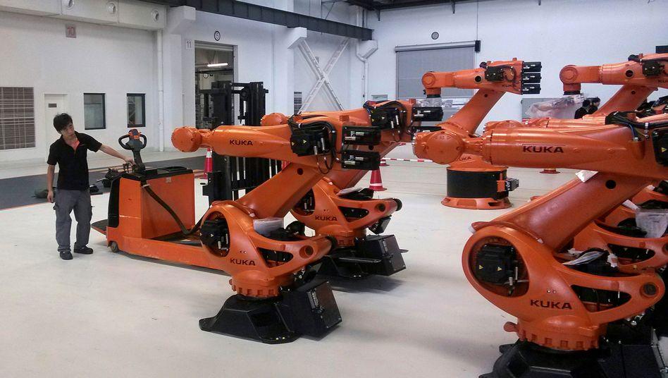 Roboterhersteller Kuka in Shanghai, China: Die Übernahme des deutschen Unternehmens durch einen chinesischen Konkurrenten im Jahr 2016 hatte eine Debatte über den Ausverkauf deutschen Know-hows befeuert