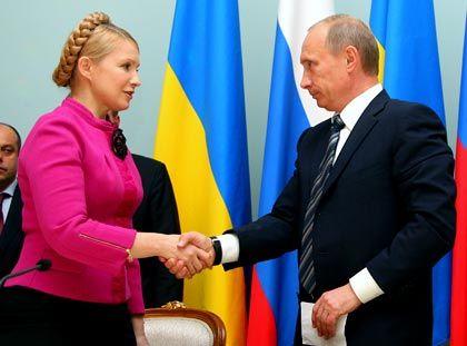 """Regierungschefs Timoschenko, Putin (r.): """"Ich hoffe, dass wir heute den Schlusspunkt gesetzt haben"""""""