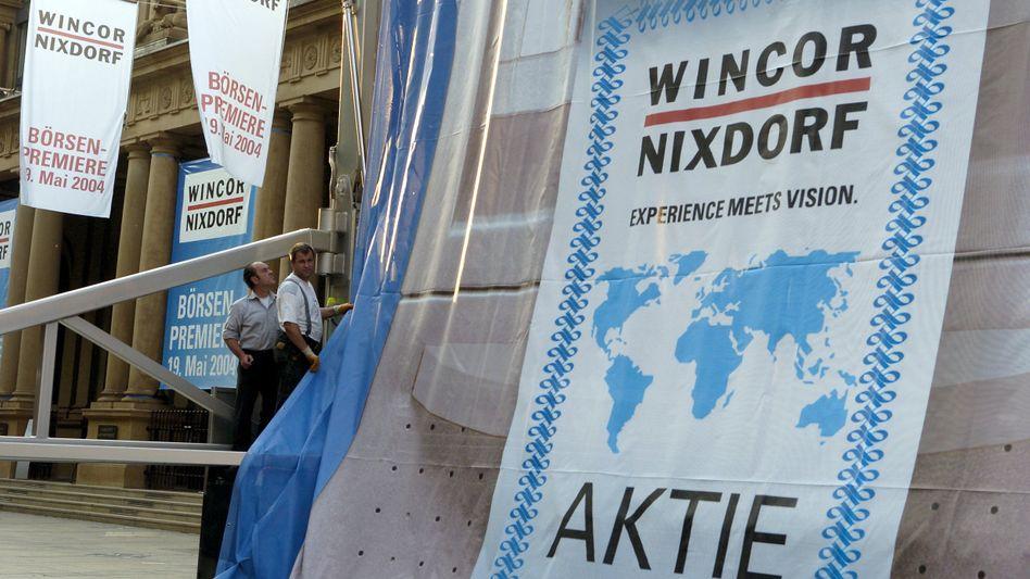 Da war es noch ein Wachstumswert: Wincor-Nixdorf-Präsentation vor der Frankfurter Börse im Jahr 2004.