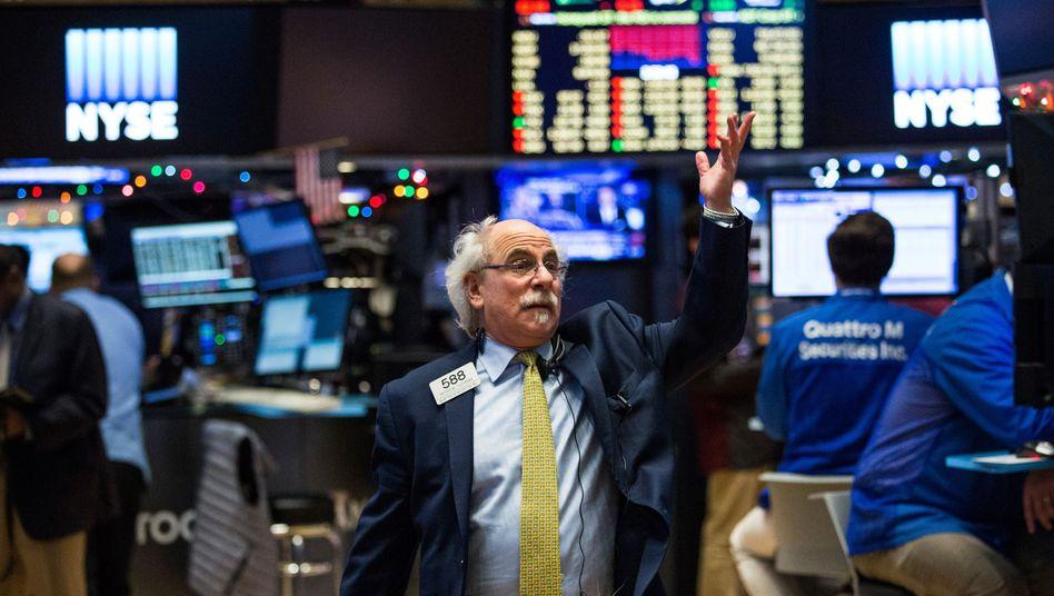 Aktienhändler in New York: Auch die US-Notenbank gibt wichtige Impulse für die hiesige Börse