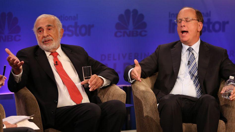 """""""Das ist es, was es in die Luft sprengen wird"""": US-Investor Icahn (links) greift das ETF-Geschäft von Blackrock an. Blackrock-Chef Larry Fink (rechts) ist über den Vorwurf sichtlich erbost"""