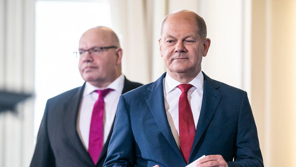 Wieder Hilfspause: Bundeswirtschaftsminister Peter Altmaier (l) und Finanzminister Olaf Scholz