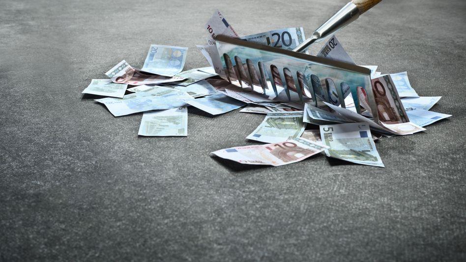 Geld: Macht Manager glücklich, aber auch besorgt