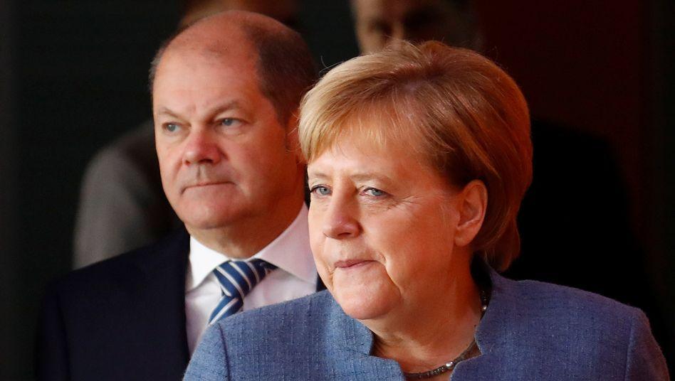 Kanzlerin Angela Merkel (CDU), Bundesfinanzminister Olaf Scholz (SPD)