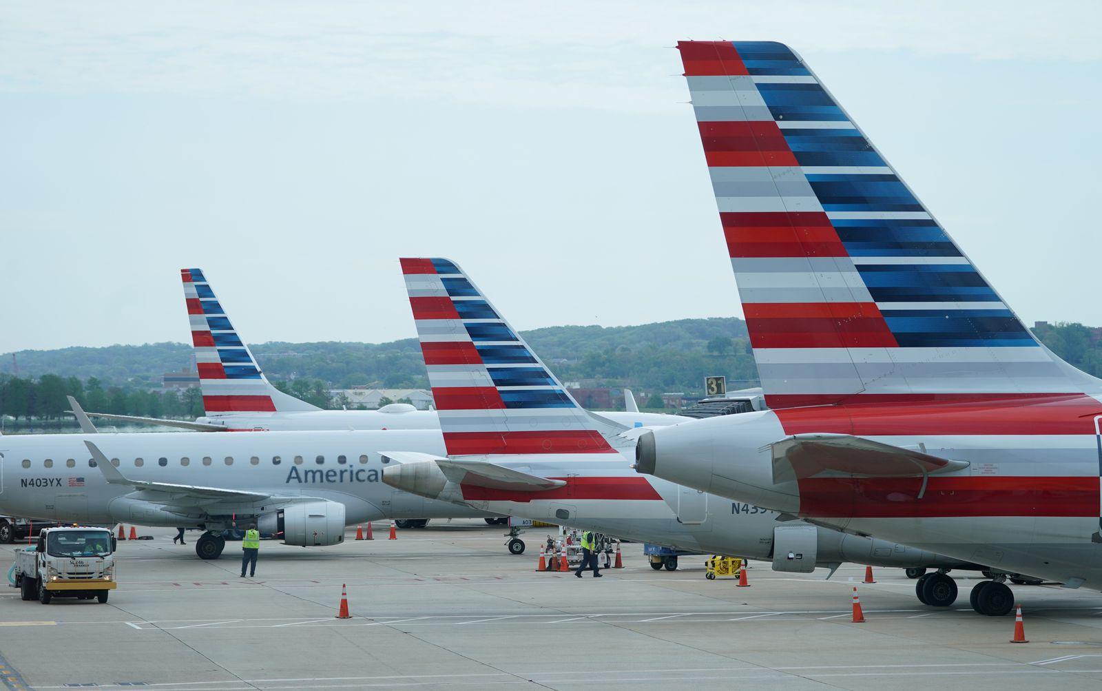 FILE PHOTO: American Airlines jets sit at gates at Washington's Reagan National airport in Washington