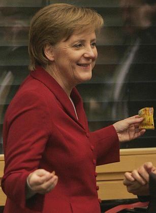"""""""Chance für Deutschland"""": Die CDU-Vorsitzende Angela Merkel verkündete am Freitagabend offiziell die Einigung von Union und SPD auf den Koalitionsvertrag"""