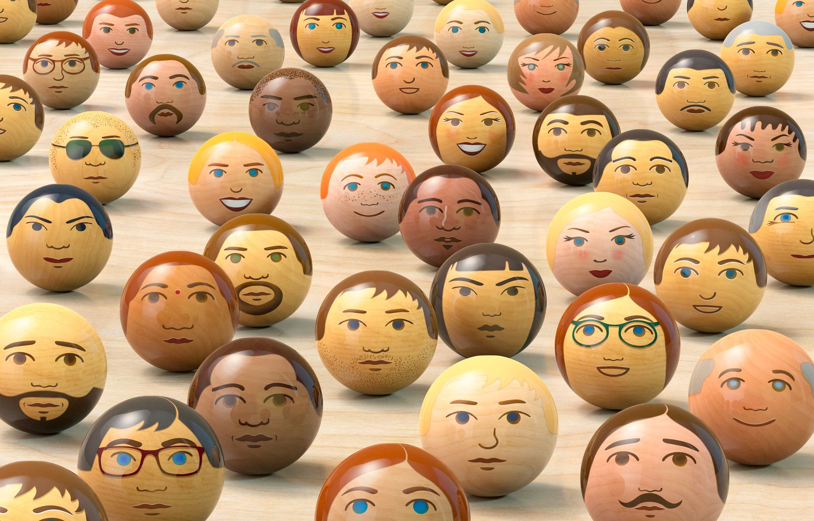 Wooden balls with multi-ethnic faces on them. (front view)