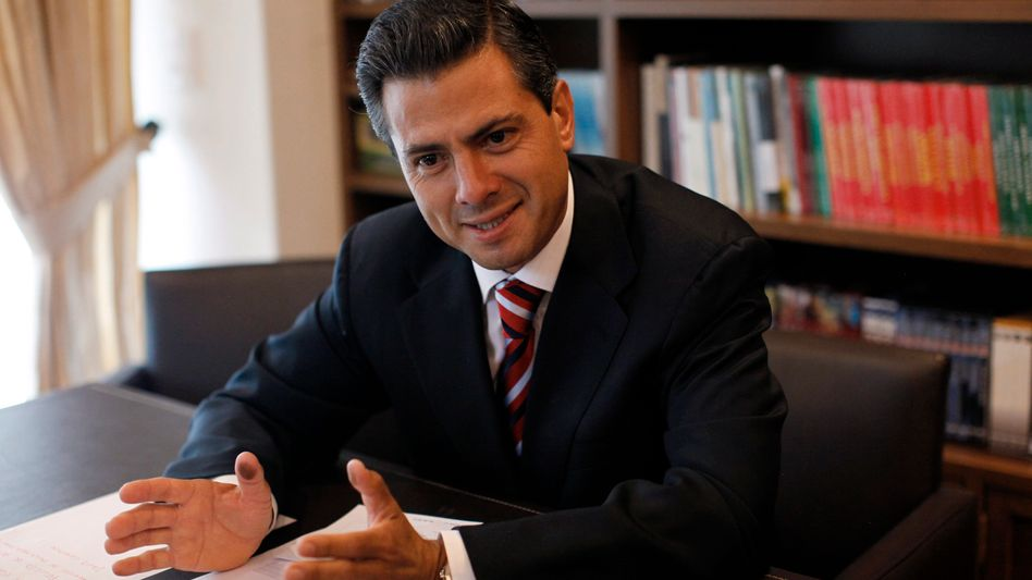 Enrique Pena Nieto speaks to international reporters in Mexico City the day after he was elected Mexico's next president.