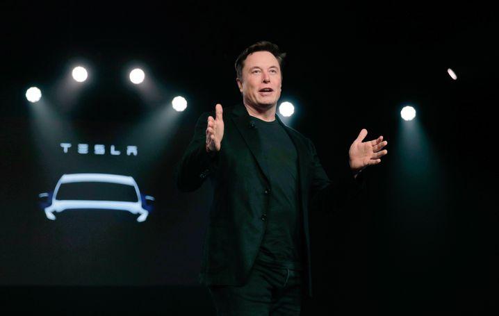 """""""Bitcoin auf Rädern"""": Je höher Teslas Kurs steigt, desto mehr entzweit Elon Musks Autobauer die Experten."""
