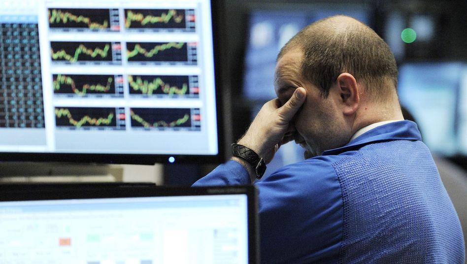 Lieber nicht hinschauen: An den Börsen in Frankfurt, New York und Tokio ging es am Dienstag wieder mal heftig bergab