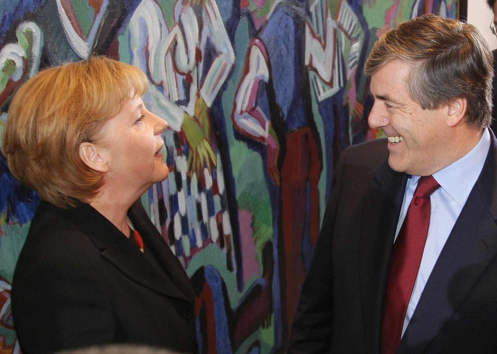 ARCHIV Merkel/ Ackermann