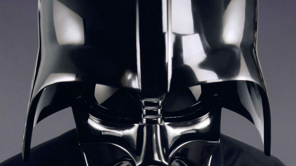 """Die dunkle Seite der Macht (Darth-Vader-Maske aus dem Film """"Star Wars""""): Nach dem Boom folgt die Verunsicherung"""