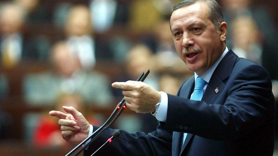 Ungehalten: Der türkische Regierungschef Erdogan droht mit einem Bruch der Beziehungen zu Frankreich