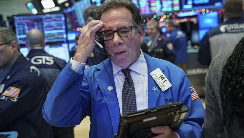 Wie war doch gleich der Name? Auch die Händler auf dem Parkett der New Yorker Börse sind vor psychologischen Einflüssen nicht gefeit.