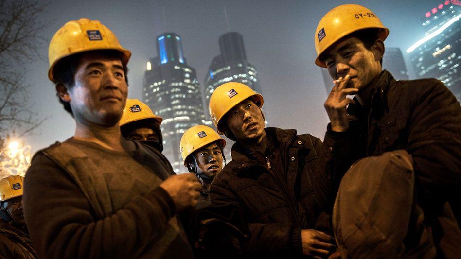 Arbeiter in Beijing: China scheint sich von der Pandemie vergleichsweise schnell zu erholen